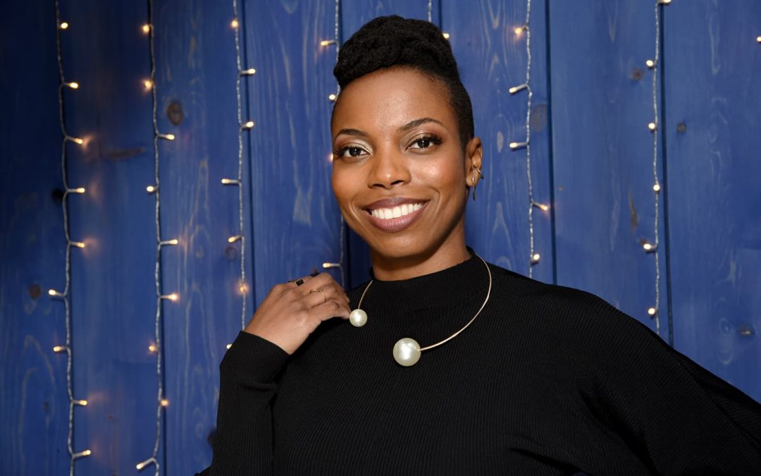 Sasheer Zamata Just Made a Strong Case for Adding an Avocado Green Couch to Your Living Room