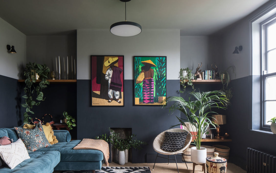 Bold paint choices create a modern yet cosy decor in this compact apartment