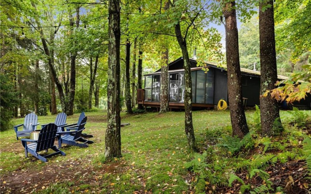 This Cabin for Sale in Upstate New York Has a Screened-In Porch and a Wood Stove