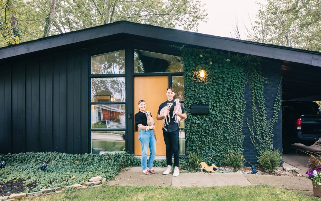A 1959 Michigan MCM House Has a Stunning Wall of Shelves & All-Black Kitchen